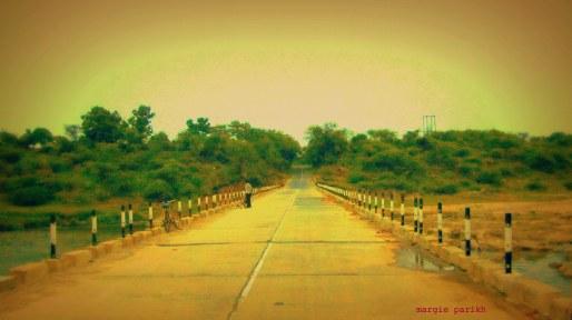 Low bridge to a sleepy town (c) margie parikh